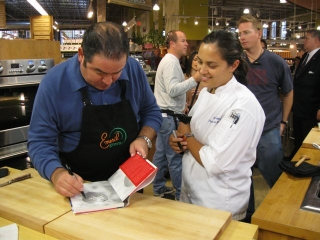 Victoria and Chef Emeril Lagasse on the set of Emeril Green